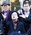 Bereaved families of Korean citizens forced into labor during the Japanese occupation of the Korean Peninsula (1910-45) express their disappointment with a decision made by the Constitutional Court in front of the courthouse in central Seoul, Wednesday. The court rejected a petition to review the constitutionality of the 1965 agreement between Japan and Korea regarding compensation for Koreans forced into wartime labor. (Yonhap)