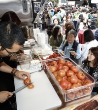 Visitors wait in front of a food truck at the KOREAT Festival held on Jeju Island in October. (Courtesy of KOREAT)
