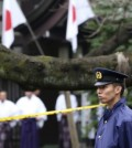 A police officer stands guard Yasukuni Shrine in Tokyo following an explosion in its public restroom. Police in Tokyo have arrested a South Korean man suspected of causing an explosion last month at the controversial shrine in Tokyo that honors Japanese war dead. The 27-year-old Jeon Chang-han was arrested Wednesday, Dec. 9 after he returned to Tokyo from South Korea for voluntary questioning, police officials said. (AP Photo/Koji Sasahara)