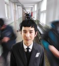 Im Su-hwan, the grand prize winner of the 4th Korea Multicultural Youth Awards, smiles in the hallway of Deogam High School in Gimje, North Joella Province, Monday. (Korea Times photo by Shim Hyun-chul)