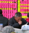 A Chinese stock investor monitors stock prices at a brokerage house in Nantong in eastern China's Jiangsu province Wednesday, Jan. 6, 2016. China plans to restrict stock sales by large shareholders once a ban imposed in July to stop a slide in prices is lifted this week. (Chinatopix via AP)