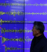 Earthquake and Volcano of the Korea Meteorological Administration Director General Yun Won-tae stands in front of a screen showing seismic waves that were measured in South Korea, in Seoul Wednesday, Jan. 6, 2016. North Korea said it conducted a powerful hydrogen bomb test Wednesday, a defiant and surprising move that, if confirmed, would be a huge jump in Pyongyang's quest to improve its still-limited nuclear arsenal. (AP Photo/Lee Jin-man)