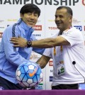 Shin Tae-yong (L), coach of South Korea's under-23 football team, and Jamal Abu Abed, coach of Jordan's under-23 team, shake hands during a press conference in Doha on Jan. 22, 2016, a day before their teams meet in the quarterfinals of the Asian U-23 Championships. (Yonhap)