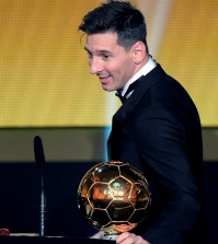 Argentina's Lionel Messi delivers a speech after winning the FIFA Men's soccer player of the year 2015 prize during the FIFA Ballon d'Or awarding ceremony at the Kongresshaus in Zurich, Switzerland, Monday, January 11, 2016. (Walter Bieri/KEYSTONE via AP))
