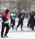 Carolina Panthers quarterback Cam Newton, left, walks across a practice field covered in snow and ice, Friday, Jan. 22, 2016, in Charlotte, N.C. The Panthers host the Arizona Cardinals in the NFC championship NFL football game on Sunday. (Jeff Siner/The Charlotte Observer via AP)