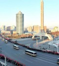 Buses carrying nuclear scientists, military officials and construction workers line a street in Pyongyang while residents cheer after North Korea conducted a fourth nuclear test on Jan. 6. Up to 100,000 citizens were mobilized for the event. North Korea's Rodong Sinmun newspaper published the photograph on Thursday. (Yonhap)