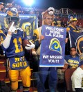 Rams fans cheer for the NFL football team at a news conference at the Forum in Inglewood, Calif., on Friday, Jan. 15, 2016. The St. Louis Rams are returning to play in 2016 in the Los Angeles area; in a few years the team will begin play at a stadium being built near the Forum. (AP Photo/Nick Ut)