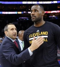 FILE - In this Nov. 2, 2015, file photo, Cleveland Cavaliers coach David Blatt pats LeBron James on the chest at the end of an NBA basketball game against the Philadelphia 76ers in Philadelphia. James' calculating image wasn't helped when the Cavaliers stunningly fired Blatt on Friday, Jan. 22, despite Blatt leading the team to the NBA Finals last season and an Eastern Conference-best 30-11 record this season. James has played for three coaches during his two stints in Cleveland, (AP Photo/Michael Perez, File)