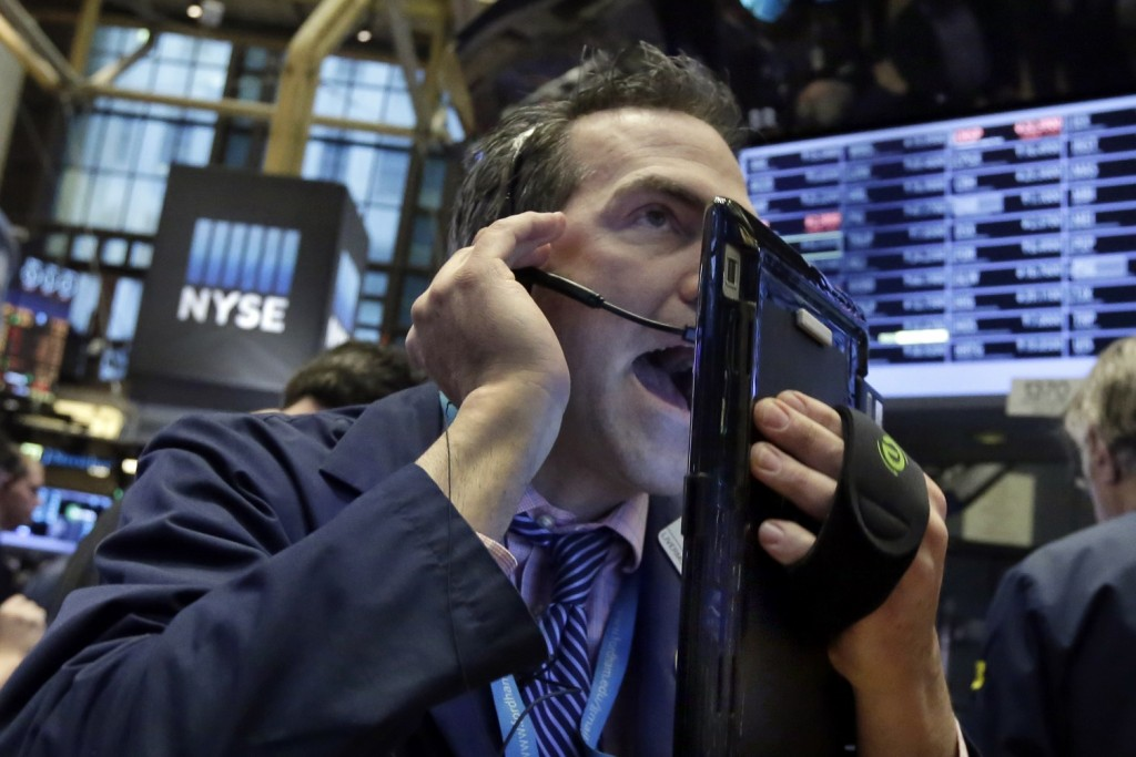 Trader Gregory Rowe works on the floor of the New York Stock Exchange, Wednesday, Jan. 20, 2016. Energy stocks are leading another sell-off on Wall Street as the price of oil continues to plunge. (AP Photo/Richard Drew)