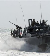 This Nov. 2, 2015, image provided by the U.S. Navy, shows Riverine Command Boat (RCB) 805 in the Persian Gulf. Iran was holding 10 U.S. Navy sailors and their two boats, similar to the one in this picture, on Jan. 12, 2016, after the boats had mechanical problems and drifted into Iranian waters. American officials have received assurances from Tehran that they will be returned safely and promptly. (Torrey W. Lee/U.S. Navy via AP)