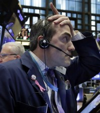 Trader Gregory Rowe works on the floor of the New York Stock Exchange, Wednesday, Jan. 6, 2016. Stocks are opening lower as investors fret about signs of belligerence in North Korea and more weakening of China's economy. (AP Photo/Richard Drew)