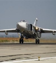 FILE - In this Oct. 22, 2015 file photo, a Russian Su-24 takes off on a combat mission at Hemeimeem airbase in Syria. Turkey said Saturday Jan. 30, 2016 that a Russian warplane SU-34 has again violated its airspace despite several warnings — two months after Turkey's military shot down a Russian jet for crossing over its territory. (AP Photo/Vladimir Isachenkov, File)