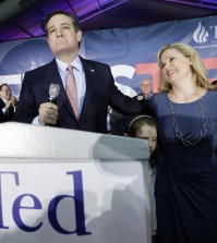 Republican presidential candidate, Sen. Ted Cruz, R-Texas, arrives for a caucus night rally with his wife Heidi, and daughter Caroline, 7, Monday, Feb. 1, 2016, in Des Moines, Iowa. (AP Photo/Charlie Neibergall)