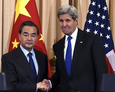 Secretary of State John Kerry, right, shakes hands with Chinese Foreign Minister Wang Yi, left, at the State Department in Washington, Tuesday, Feb. 23, 2016. (AP Photo/Susan Walsh)