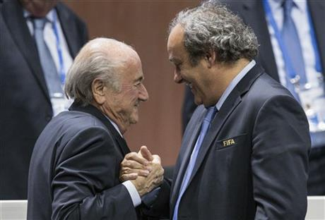 FILE - In this Friday, May 29, 2015 file photo, FIFA president Sepp Blatter is greeted by UEFA President Michel Platini, right, after Blatters re-election as president at the Hallenstadion in Zurich, Switzerland. Sepp Blatter and Michel Platini have been banned for 8 years, the FIFA ethics committee said Monday, Dec. 21, 2015. (Patrick B. Kraemer/Keystone via AP, File)