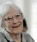 "FILE - In this Aug. 20, 2007, file photo, author Harper Lee smiles during a ceremony honoring the four new members of the Alabama Academy of Honor at the Capitol in Montgomery, Ala. Harper Lee, the elusive author whose ""To Kill a Mockingbird"" became an enduring best seller and classic film with its child's-eye view of racial injustice in a small Southern town, has died according to Harper Collins spokeswoman Tina Andreadis. She was 89. (AP Photo/Rob Carr, File)"