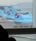 Korean Air Lines planes are visible outside a window at a departure gate of Incheon International Airport, west of Seoul, on Feb. 19, 2016. Unionized pilots of South Korea's No. 1 carrier voted for a strike on the day which, if carried out, would be the first in 11 years. The pilots demanded a 37 percent wage hike, while the management offered a 1.9 percent increase. The union said it is not planning on an immediate walkout, but will gradually raise the strike participation level depending on how talks proceed with the management. (Yonhap)