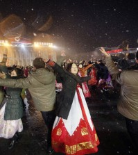 North Koreans dance on the Kim Il Sung Square to celebrate a satellite launch Monday, Feb. 8, 2016, in Pyongyang, North Korea. People in Pyongyang danced and watched fireworks the day after a rocket launch that has been strongly condemned by many countries around the world. (AP Photo/Jon Chol Jin)