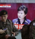 South Korean army soldiers pass by a TV screen showing the live broadcast of South Korean President Park Geun-hye's speech, at the Seoul Railway Station in Seoul, South Korea, Tuesday, Feb. 16, 2016. President Park warns of North Korean collapse if it doesn't abandon its nuclear program. (AP Photo/Ahn Young-joon)