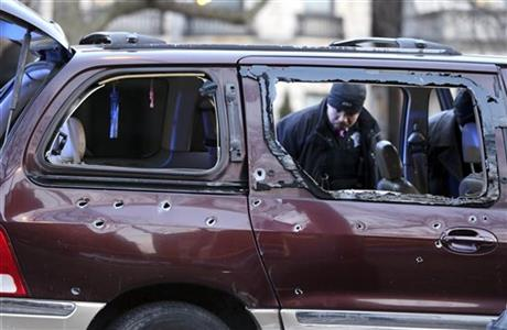 In this Jan. 19, 2016 photo, Chicago police investigate the scene where multiple people were shot on the city's South Side. Chicago police said Monday, Feb. 1, 2016, the number of homicides in the city climbed dramatically in January to 51, in the bloodiest start to a year in at least 16 years. They said there were 22 more homicides this January than in January 2015 and that the number of shooting incidents during the same period more than doubled to 242. (Chris Sweda/Chicago Tribune via AP)