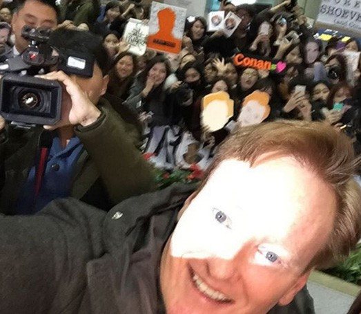 Conan O'Brien had used Instagram to invite fans to greet him at the airport, and they obliged. (Courtesy of Instagram)