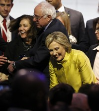Democratic presidential candidates, Hillary Clinton and Sen. Bernie Sanders, I-Vt, talk to supporters after a Democratic presidential primary debate at the University of Wisconsin-Milwaukee, Thursday, Feb. 11, 2016, in Milwaukee. (AP Photo/Morry Gash)