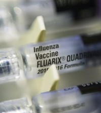 FILE - This Thursday, Nov. 12, 2015 file photo shows single dosage syringes of the Fluarix quadrivalent influenza virus vaccine in New York. According to numbers presented at a medical meeting in Atlanta on Wednesday, Feb. 24, 2016, the flu vaccine is doing a better job in 2016. (AP Photo/Patrick Sison)