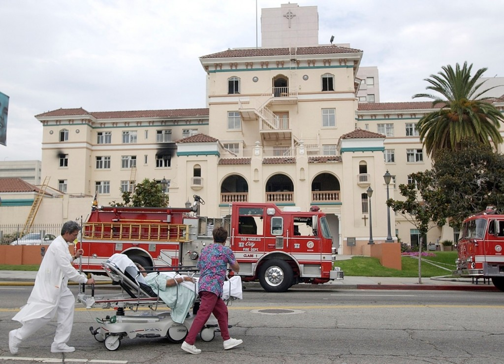 """FILE - In this July 22, 2003, file photo, nurses evacuate a patient after a fire broke out on the third floor of the 434-bed the formerly named Queen of Angels-Hollywood Presbyterian Medical Center, with visibly blackened windows, in the Hollywood section of Los Angeles. The FBI says Wednesday, Feb. 17, 2016, it is investigating a computer network extortion plot at the Los Angeles hospital. In the attacks known as """"ransomware,"""" hackers lock up an institution's computer network and demand payment to reopen them. FBI spokeswoman Laura Eimiller said Wednesday that the agency is investigating such a plot at the Hollywood Presbyterian Medical Center. (AP Photo/Nick Ut, File)"""
