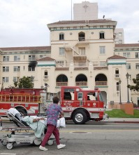 "FILE - In this July 22, 2003, file photo, nurses evacuate a patient after a fire broke out on the third floor of the 434-bed the formerly named Queen of Angels-Hollywood Presbyterian Medical Center, with visibly blackened windows, in the Hollywood section of Los Angeles. The FBI says Wednesday, Feb. 17, 2016, it is investigating a computer network extortion plot at the Los Angeles hospital. In the attacks known as ""ransomware,"" hackers lock up an institution's computer network and demand payment to reopen them. FBI spokeswoman Laura Eimiller said Wednesday that the agency is investigating such a plot at the Hollywood Presbyterian Medical Center. (AP Photo/Nick Ut, File)"