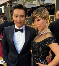 "South Korean actor Lee Byung-hun and soprano Sumi Jo pose together at the Academy Awards in Los Angeles on Feb. 28, 2016 (local time). Lee is South Korea's first presenter at the Oscars, while Jo is the country's first nominee for an award. Jo was nominated in the Best Original Song category for her ""Simple song #3"" in the film ""Youth."" This photo was provided by Seo Seung-yeon, the designer of Jo's dress. (Yonhap)"