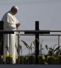 Pope Francis stands a platform near the U.S.-Mexico border fence along the Rio Grande, in Ciudad Juarez, Mexico, Wednesday, Feb. 17, 2016, as seen from in El Paso, Texas, Wednesday, Feb. 17, 2016. Francis made the sign of the cross and blessed hundreds of people gathered in El Paso. (AP Photo/Eric Gay)