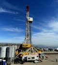 FILE - In this Dec. 9, 2015, pool file photo, crews work on stopping a gas leak at a relief well at the Aliso Canyon facility above the Porter Ranch area of Los Angeles.The utility says it has stopped the natural gas leak near Los Angeles after nearly 4 months. (Dean Musgrove/Los Angeles Daily News via AP, Pool, File)