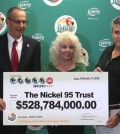 Florida Lottery Secretary Tom Delacenserie, left, presents Maureen Smith and David Kaltschmidt with their one-third share of the Jan. 13, world record Powerball jackpot Wednesday, Feb. 17, 2016, in Tallahassee, Fla. John and Lisa Robertson of Munford, Tenn., cashed in their ticket last month, also taking the lump sum. The winners in California have not publicly come forward yet. (AP Photo/Steve Cannon)