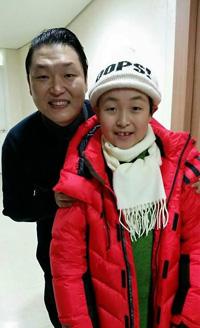 Jun, right, and Psy ( Yonhap)