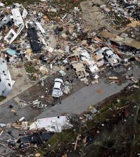 This aerial photo shows damage after a tornado ripped through the Sugar Hill Recreational Park in the town of Convent, in southern La., Wednesday, Feb. 24, 2016. Tornadoes ripped through the RV park in Louisiana and significantly damaged nearly 100 homes and apartments in Florida as a deadly storm system rolled across the South, and forecasters warned that more twisters were possible Wednesday along the East Coast. (David Grunfeld/NOLA.com The Times-Picayune via AP)