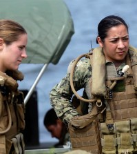 U.S. Navy Master-at-Arms Third Class Danielle Hinchliff, left, and Master-at-Arms Third Class Anna Schnatzmeyer listen during training in 2013. (Gerry Broome / AP, file)