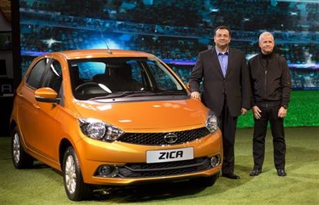 "Tata Motors Chairman Cyrus Mistry, left, and Tim Leverton, head of Tata Engineering and Research and Development, pose for photographers during the unveiling of Zica at a press preview of Auto Expo in Greater Noida, near New Delhi, India, Wednesday, Feb. 3, 2016. The Zika virus has hit India's Tata Motors, which has decided to rebrand soon-to-be launched hatchback vehicle which was to have been called Zica, an abbreviation of ""Zippy Car."" Tata Motors said in a statement Tuesday that the car would carry the Zica nameplate during the exhibition, but a new name will be announced in a few weeks. (AP Photo/Manish Swarup)"