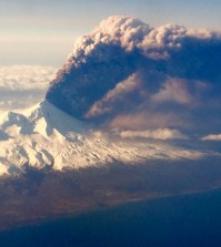 In this Sunday, March 27, 2016, photo, Pavlof Volcano, one of Alaska's most active volcanoes, erupts, sending a plume of volcanic ash into the air. The Alaska Volcano Observatory says activity continued Monday. Pavlof Volcano is 625 miles southwest of Anchorage on the Alaska Peninsula, the finger of land that sticks out from mainland Alaska toward the Aleutian Islands. (Colt Snapp via AP)