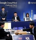 South Korean Go grandmaster Lee Se-dol (R) makes the first move in his highly anticipated showdown with the Google-developed supercomputer AlphaGo at the Four Seasons hotel in downtown Seoul on March 9, 2016, in this photo released by Google. (Yonhap)