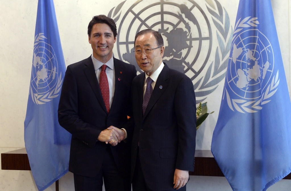Canadian Prime Minister Justin Trudeau, left, shakes hands with United Nations General Secretary Ban Ki-moon at the United Nations headquarters  Wednesday March 16, 2016. (Adrian Wyld /The Canadian Press via AP)