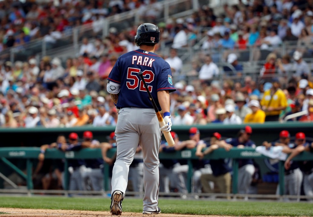 Minnesota Twins' Byung Ho Park, of South Korea, walks off the field after striking out swinging in the third inning of a spring training baseball game against the Boston Red Sox in Fort Myers, Fla., Wednesday, March 2, 2016. (AP Photo/Patrick Semansky)