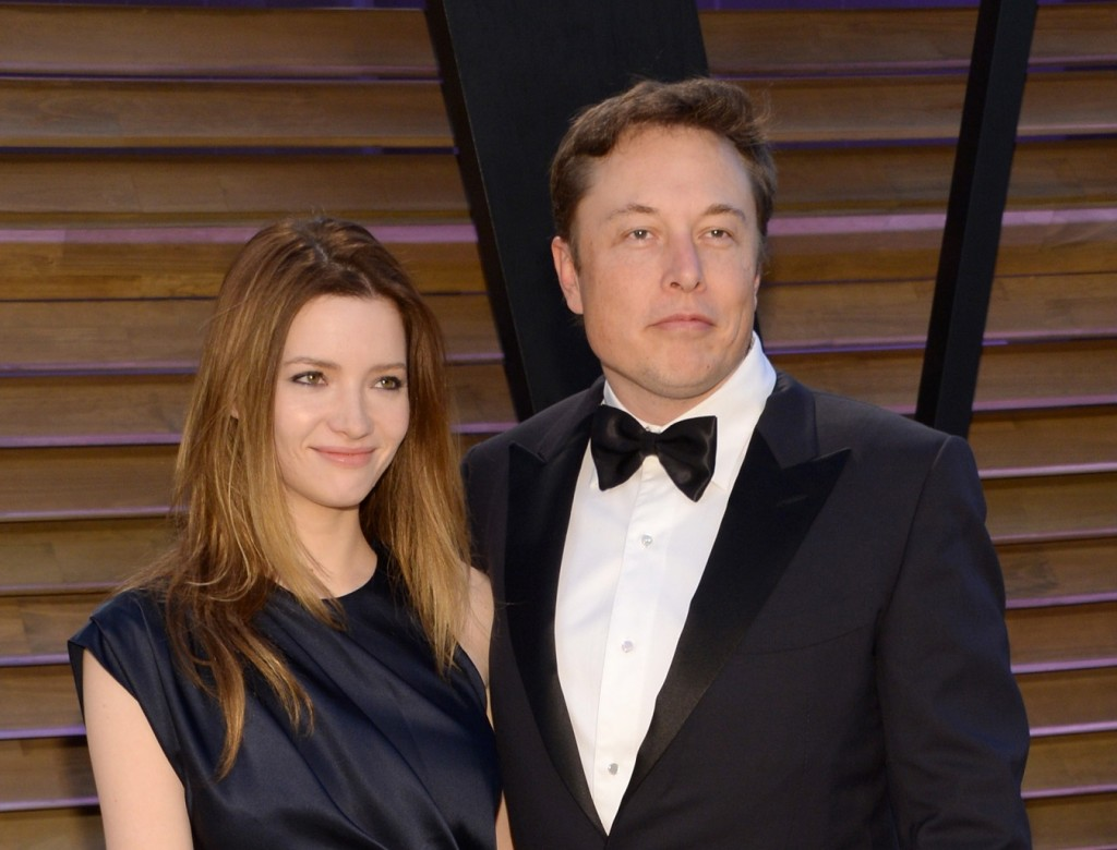 FILE - In this March 2, 2014 file photo, Talulah Riley, left, and Elon Musk attend the 2014 Vanity Fair Oscar Party, in West Hollywood, Calif. Riley has filed to end her second marriage to billionaire entrepreneur Elon Musk. Riley's filing Monday, March 21, 2016, in Los Angeles Superior Court is the second attempt to end the pair's second marriage. Musk filed for divorce on New Year's Eve in 2014 but withdrew the petition seven months later. (Photo by Evan Agostini/Invision/AP, File)