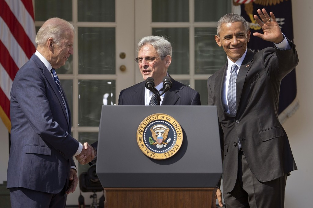 Federal appeals court judge Merrick Garland, center, stands with President Barack Obama and Vice President Joe Biden after being introduced as Obama's nominee for the Supreme Court during an announcement in the Rose Garden of the White House, in Washington, Wednesday, March 16, 2016.  Garland, 63, is the chief judge for the United States Court of Appeals for the District of Columbia Circuit, a court whose influence over federal policy and national security matters has made it a proving ground for potential Supreme Court justices.  (AP Photo/Pablo Martinez Monsivais)