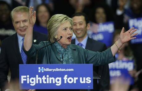 Democratic presidential candidate Hillary Clinton, center, speaks as Seattle Mayor Ed Murray, left, and his husband, Michael Shiosaki, right, look on Tuesday, March 22, 2016, during a campaign rally at Rainier Beach High School in Seattle. (AP Photo/Ted S. Warren)