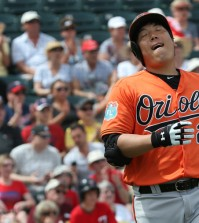 Baltimore Orioles' Kim Hyun-soo gestures after being called out on first base during a spring training game against the Minnesota Twins in Fort Myers, Fla., Saturday. Kim went 0 for 4. (Yonhap)