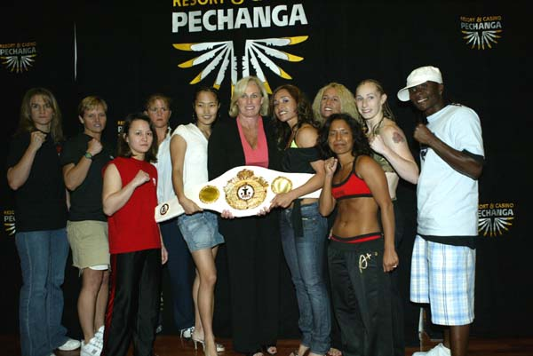 Judy Kulis, middle, was always able to attract the biggest names in women's boxing to fight for IFBA titles, and helped grow the sport internationally with dozens of fights throughout Asia and even bringing over Choi Shin-hee, to her left, to the U.S. to fight.