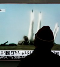 A man watches a TV screen showing a file footage of the missile launch conducted by North Korea, at Seoul Railway Station in Seoul, South Korea, Monday, March 21, 2016. North Korea fired short-range projectiles into the sea on Monday, Seoul officials said, in a continuation of weapon launches it has carried out in an apparent response to ongoing South Korea-U.S. military drills it sees as a provocation. (AP Photo/Lee Jin-man)