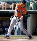 Baltimore Orioles' Hyun Soo Kim swings at a pitch in the first inning of a spring training baseball game against the Atlanta Braves, Tuesday, March 1, 2016, in Kissimmee, Fla. (AP Photo/John Raoux)