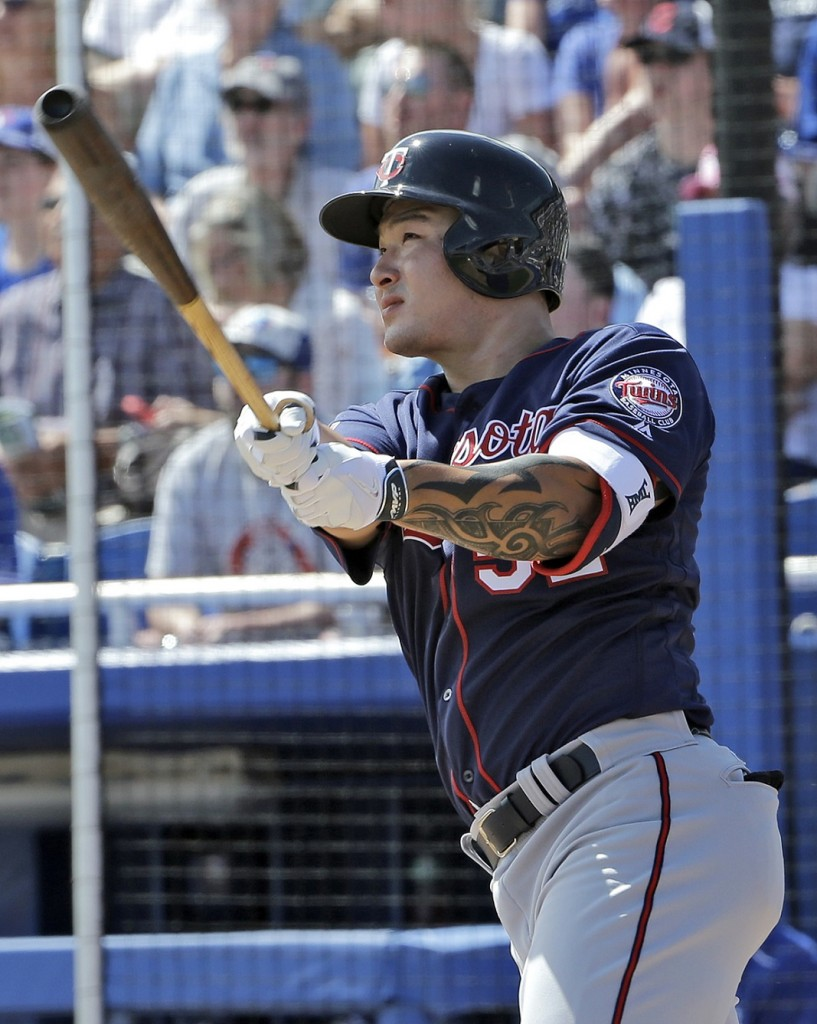 Minnesota Twins' Park Byung-ho, of South Korea, follows the flight of his home run off Toronto Blue Jays starting pitcher Gavin Floyd during the second inning of a spring training baseball game Tuesday, March 8, 2016, in Dunedin, Fla. (AP Photo/Chris O'Meara)