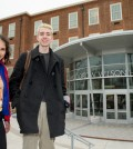 High School juniors Brian Keyes and Isabel Suarez, both 16, pose for a photograph in front of Woodrow Wilson High School in Washington, Thursday, March 3, 2016, after recently taking the new SAT exam. The new exam focuses less on arcane vocabulary words and more on real-world learning and analysis by students. Students no longer will be penalized for guessing. And the essay has been made optional. (AP Photo/Andrew Harnik)